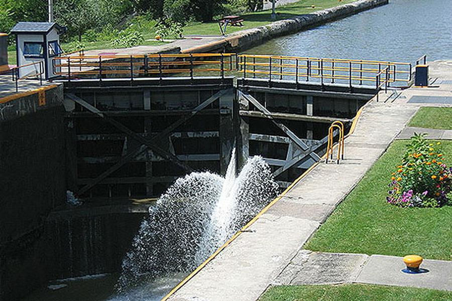 As water pours through a lock the level falls to that of the next section