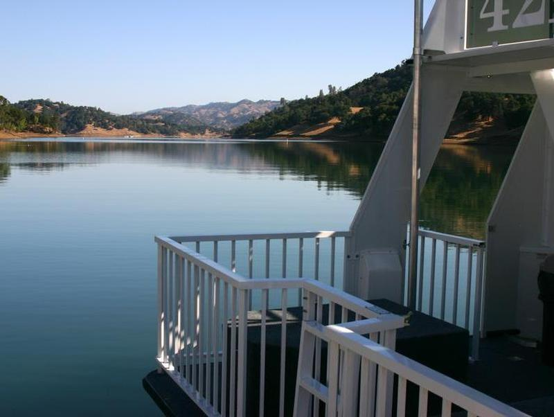Take in a peaceful view of the lake from the deck of the houseboat Photos