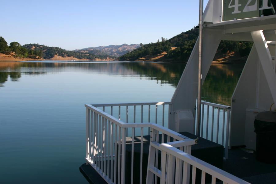 Take in a peaceful view of the lake from the deck of the houseboat