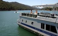 Take turns relaxing on the top deck and cruising on the lake