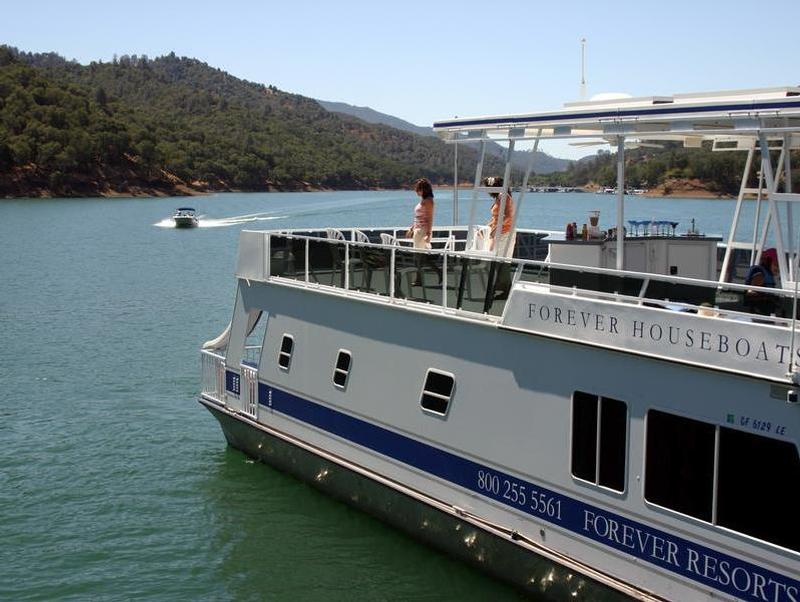 Take turns relaxing on the top deck and cruising on the lake Photos