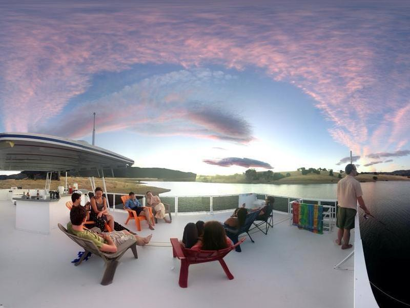 Reconnect with friends and family on the houseboat's top deck Photos