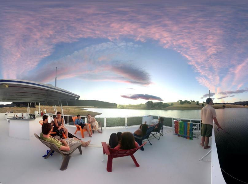Reconnect with friends and family on the houseboat's top deck