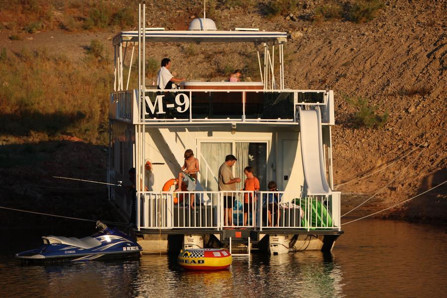 Rest in your houseboat on shore after a long fun day in the sun