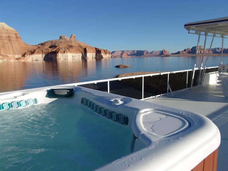 Travel in luxury as you relax on the large top deck in warm waters