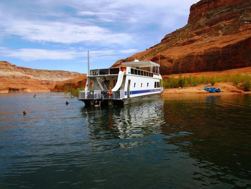 Park your houseboat on shore and cool off from a day in the sun Photos