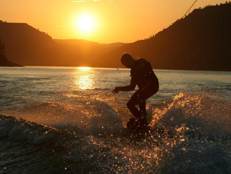 Wake boarding at sunset makes for striking memories Photos