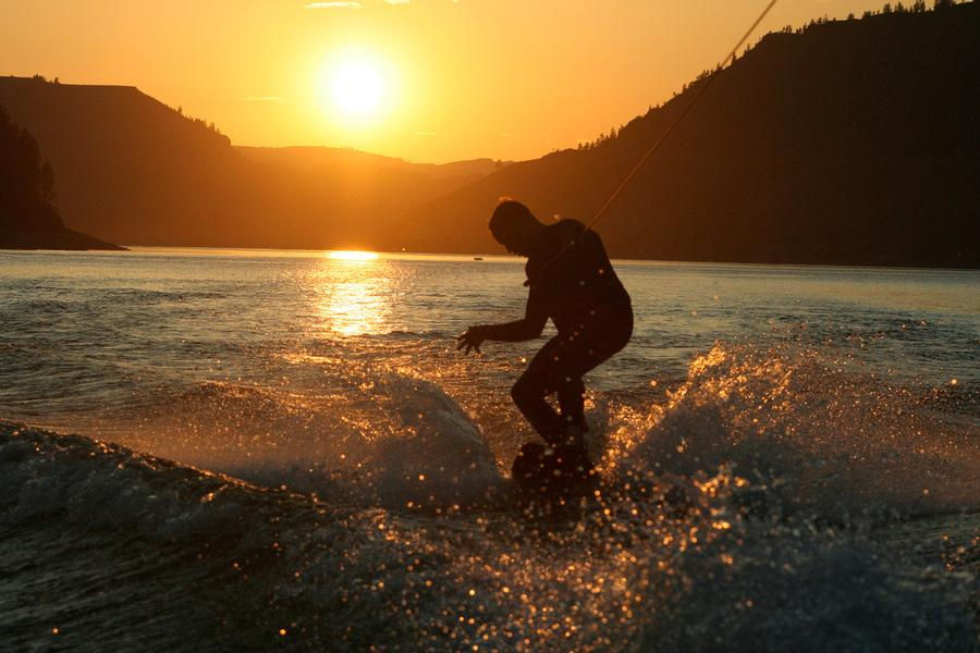 Wake boarding at sunset makes for striking memories