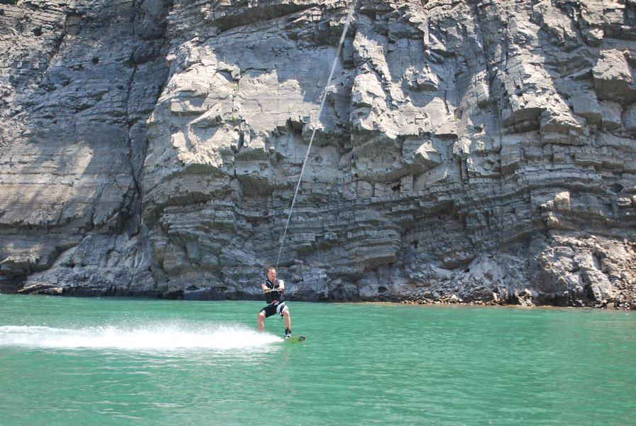 Towering cliffs offer a picturesque background while riding the waters