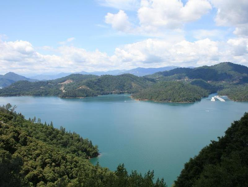 Take a hike up the hills to enjoy a breathtaking view of Shasta Lake Photos