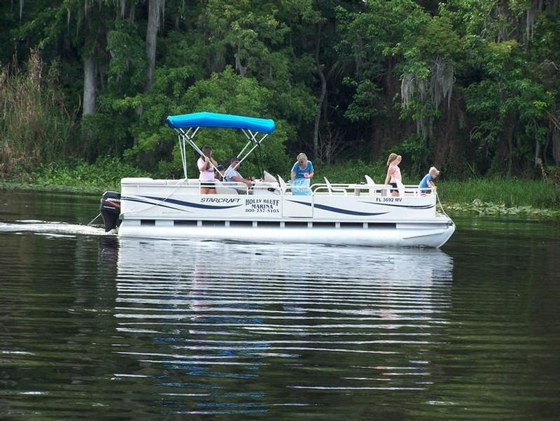 Enjoy a sunny day out on the water aboard a cozy Pontoon Picnic Boat Photos