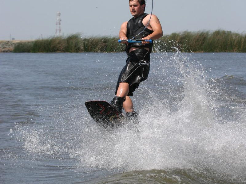 Take a speedboat out for some intense wake boarding Photos