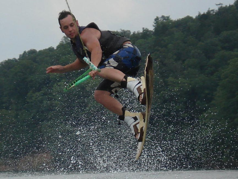 Catch some mad air while jumping some awesome wake at the lake Photos