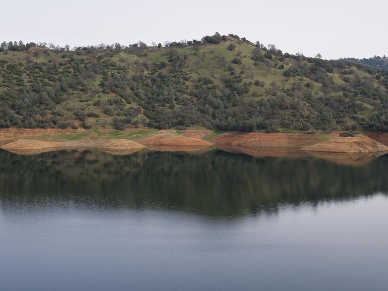 Lake Don Pedro is surrounded by forest and lined with beaches Photos