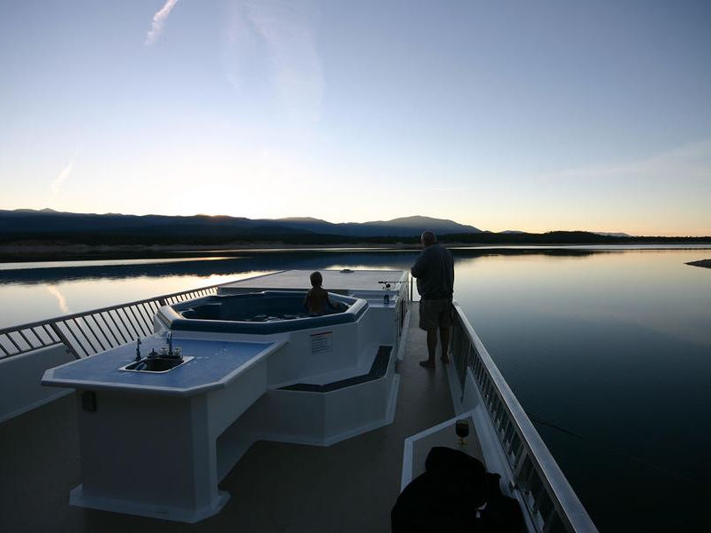 End your day in the sun on the top deck sourrounded by the sunset Photos