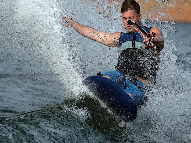 Show off your kneeboarding skills out on the open waters Photos