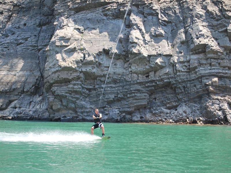 Towering cliffs offer a picturesque background while riding the waters Photos